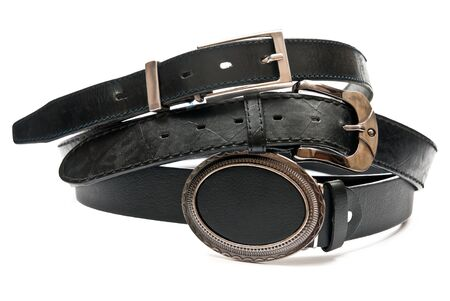 Three leather belts isolated on white background