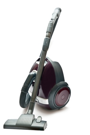 Red vacuum cleaner isolated on the white background photo