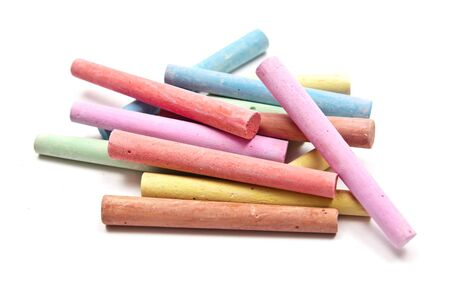 stimuli: Colored chalks on white background with soft shadows. Stock Photo