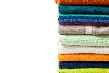 Pile of bright color towels isolated on withe background photo