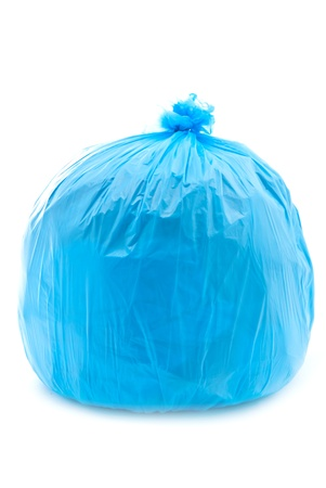 Tied blue garbage bag isolated on a white background photo
