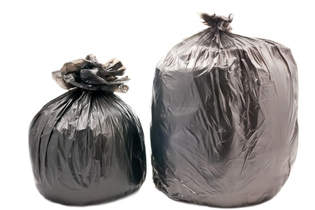 black plastic garbage bag: Two black garbage bags isolated on white background Stock Photo