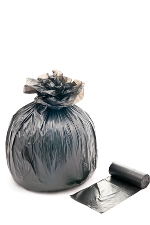 One black garbage bag isolated on white background photo