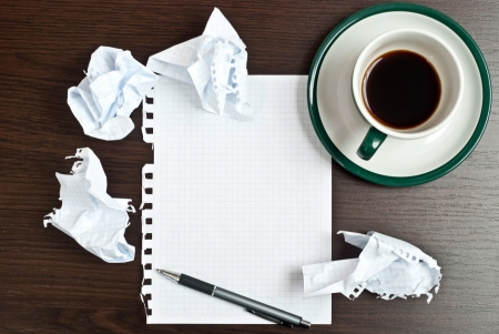 Pencil on a white paper with cup of coffee on dark desk Stock Photo