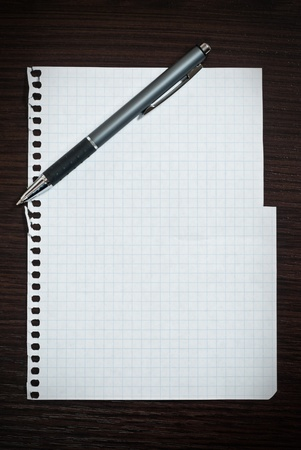 Notepad page and pen on dark wooden desk Stock Photo - 9085016