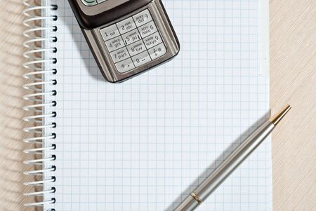 Mobile phone, notepad and pen on wood desk Stock Photo - 9085019