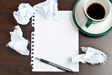 writing letter: Pencil on a white paper with cup of coffee on dark desk Stock Photo