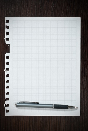 Notepad page and pen on black wooden desk Stock Photo - 9085006