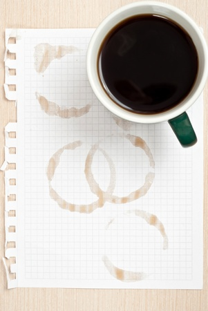 cup four: Coffee rings and cup of coffee stains on white paper background Stock Photo