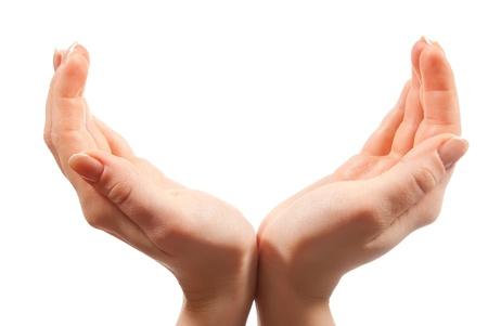 personas ayudandose: Closeup hembra abri� manos aislados en blanco Foto de archivo