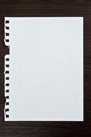Notepad page on black wooden desk photo