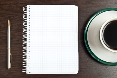 Notebook, silver pen and coffee in green cup on desk Stock Photo - 9085128