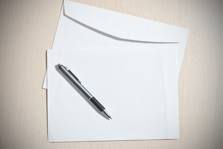 Two white envelopes with pen on desk Stock Photo - 9085094