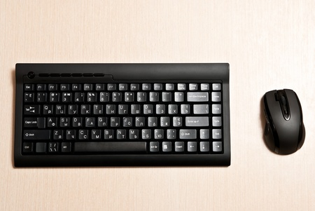 Black keyboard and mouse on a desk. photo