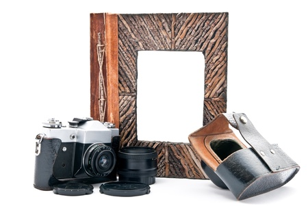 Vintage camera  and photo album with empty picture. Isolated on white. Focus on camera photo