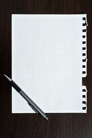 Notepad page and pen on black wooden desk Stock Photo - 9293406