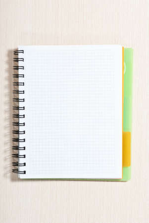 Blank spiral note pad on wood desk Stock Photo - 9293355