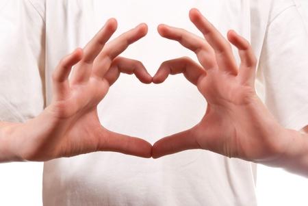 manos abiertas: Forma de coraz�n hechas a mano. Sobre fondo blanco