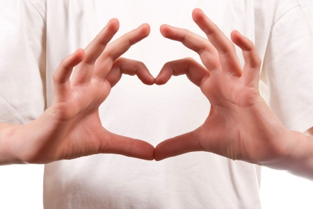 Hand made heart shape. On white background photo