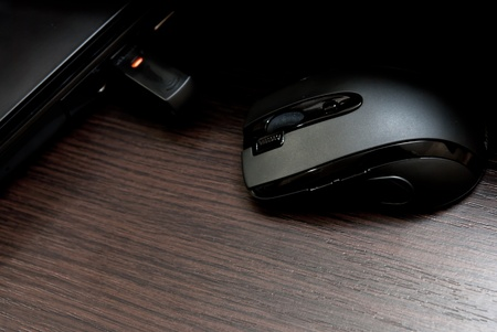 Black keyboard and mouse on a wood desk  photo