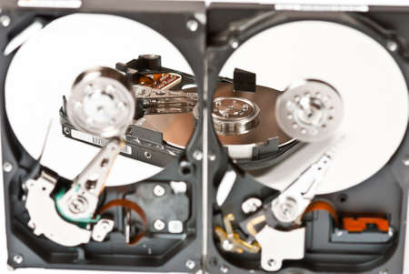 Opened hard disks on white background. Studio shot Stock Photo - 9327052