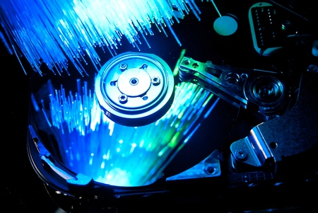Hard disc with fiber optics background. Studio shot Stock Photo - 9325070