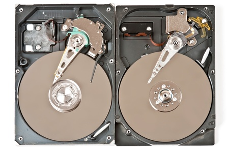 Two opened hard disks on white background. Studio shot photo