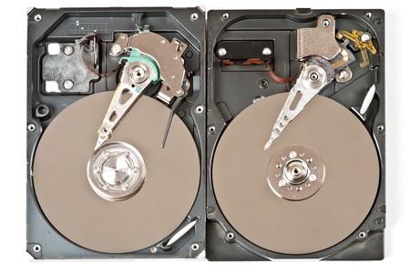 Two opened hard disks on white background. Studio shot photo