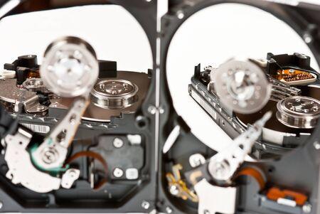 Opened hard disks on white background. Studio shot photo