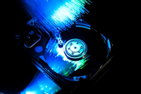 Hard disc with fiber optics background. Studio shot Stock Photo - 9323211