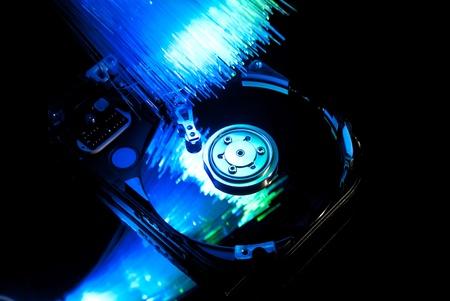 Hard disc with fiber optics background. Studio shot Stock Photo - 9323211
