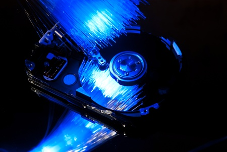 Hard disc with fiber optics background. photo