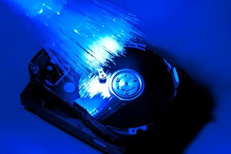 Hard disc with fiber optics background. Studio shot Stock Photo - 9455844