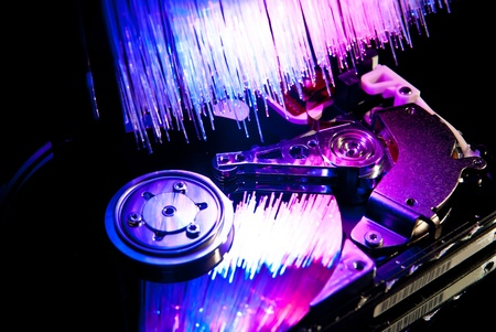 Computer opened hard disc with fiber optics background. Stock Photo - 9460945