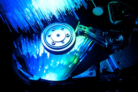 Hard disc with fiber optics background. Studio shot Stock Photo - 9460770