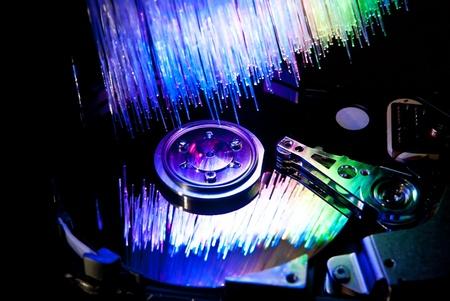 Computer hard disc with fiber optics background. Studio shot Stock Photo - 9460708
