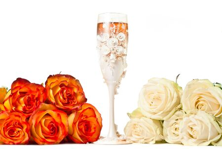 One glass of champagne and a roses against white background. photo