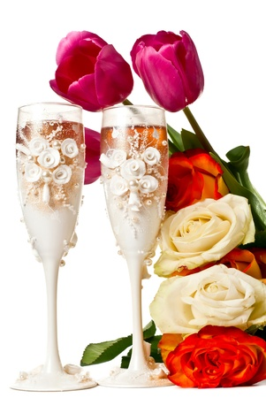Two glasses of celebratory champagne with roses and tulips. Isolated on white Stock Photo - 9612452