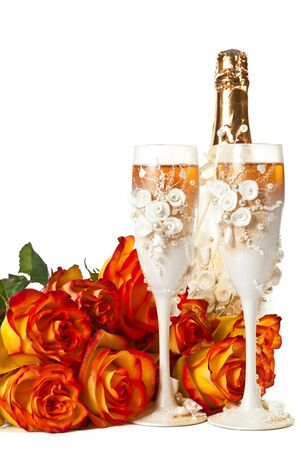 Two glasses of champagne and a roses against white background. photo