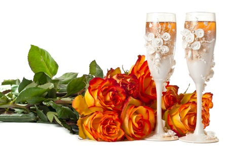 One glas of champagne and a roses against white background. photo