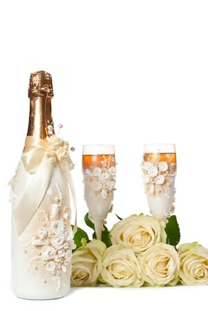 Two glasses of celebratory champagne with white roses photo