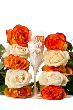 One beautiful glass of champagne and a roses against white background. photo