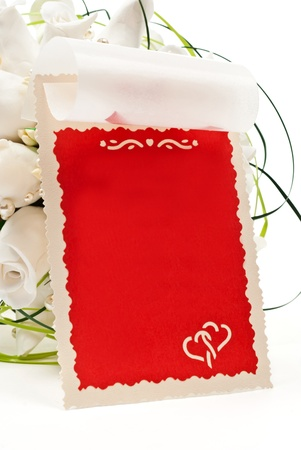 Roses on white background with empty card. photo