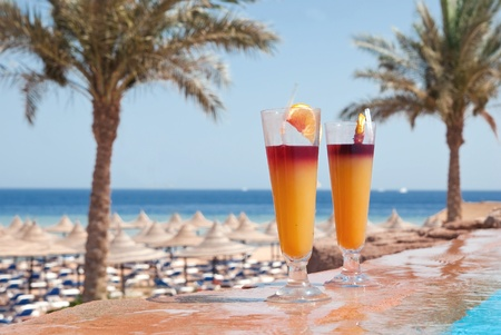 Two glasses of alcohol fruit cocktails at the pool near sea Stock Photo - 10771069