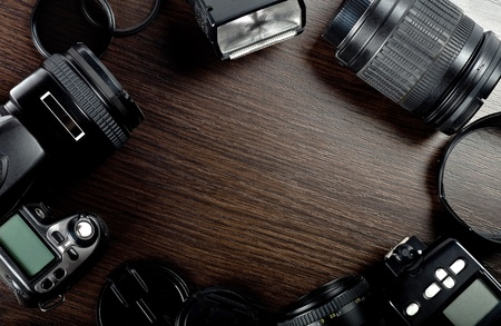 Modern phototechnics. Camera, lens, flash. Stock Photo - 12134642