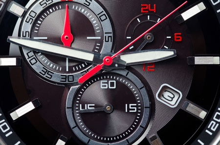Sport black and red wristwatch. Macro shot