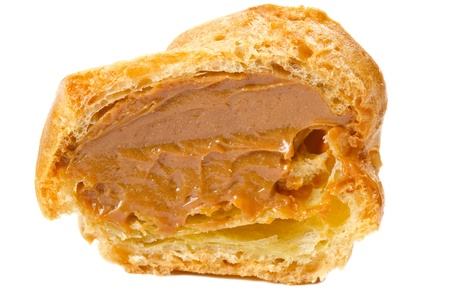 Fresh cream puffs isolated on white photo