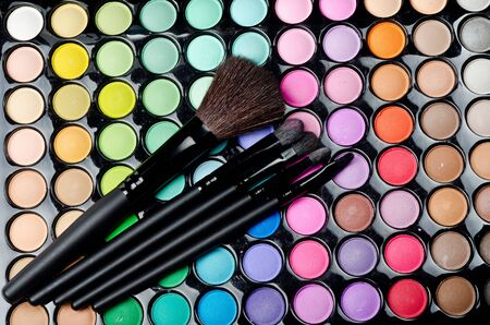 Professional makeup brushes and cosmetics photo