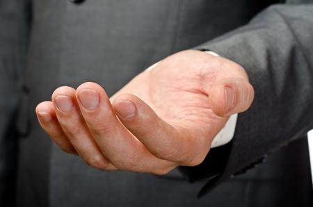 Businessman empty open hand. Studio shot photo