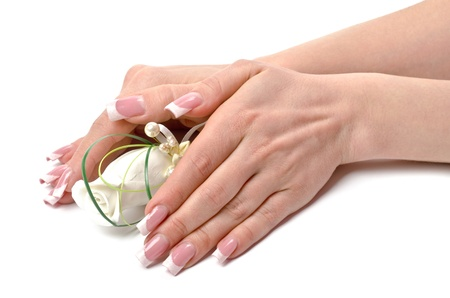 Female hands with perfect manicure and flowers - beauty treatment Stock Photo - 13098828